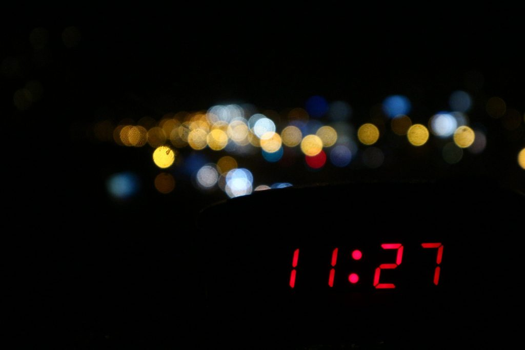 Clock showing late time when nighttime trash collections may be occurring